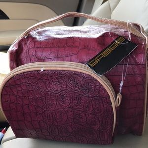 Brand new carrying case with make up bag burgundy